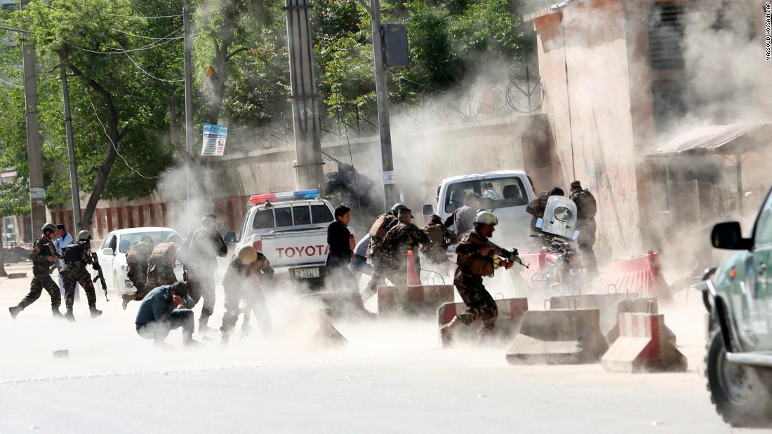 "Security forces run from the site of a suicide bombing in Kabul, Afghanistan, on Monday, April 30. <a href=""https://www.cnn.com/2018/04/30/asia/afghanistan-kabul-blasts-intl/index.html"" target=""_blank"">The two explosions</a> were close to NATO's Afghan headquarters, the US embassy and Afghan government buildings."