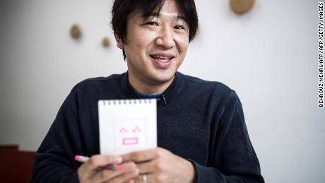 "Japanese Shigetaka Kurita, the man who created emoji charachters, shows an emoji charachter after drawing during an interview with AFP in Tokyo on November 30, 2016. Kurita was working at major telecom NTT Docomo in 1999 when he sketched out one of the first emoji, a clunky looking thing barely recognisable as the precursor to today's yellow smiley face. From a humble smiley face with a box mouth and inverted ""V's"" for eyes, crude weather symbols, and a rudimentary heart -- emoji have now exploded into the world's fastest-growing language. / AFP / Behrouz MEHRI / TO GO WITH AFP STORY: Japan-culture-computers, INTERVIEW by Miwa Suzuki and Anne Beade        (Photo credit should read BEHROUZ MEHRI/AFP/Getty Images)"
