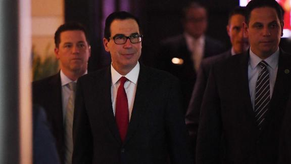 US Treasury Secretary Steven Mnuchin (C) walks through a hotel lobby as he heads to the US embassy in Beijing on May 3, 2018. - Top US and Chinese officials prepared on May 3 to kick off crucial trade talks in Beijing but both sides sought to dampen expectations for a quick resolution to a heated dispute between the world's two largest economies. (Photo by GREG BAKER / AFP)        (Photo credit should read GREG BAKER/AFP/Getty Images)