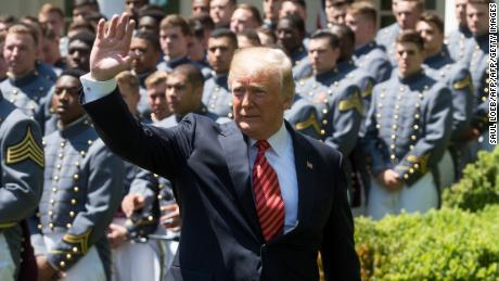 US President Donald Trump waves after speaking during a presentation of the Commander-in-Chief's Trophy to the US Military Academy football team in the Rose Garden of the White House in Washington, DC, May 1, 2018. (Photo by SAUL LOEB / AFP)        (Photo credit should read SAUL LOEB/AFP/Getty Images)