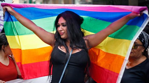 A woman holds the rainbow flag of the LGBT movement as she marches during ongoing celebrations of International Women's Day in Beirut on March 11.