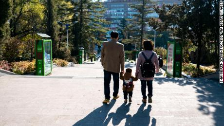 CHINA - 2016/10/23: A couple of young parents take their only kid's hand walking on the road.  China has one of the worlds lowest total fertility rates.  According to the 2016 China Statistical Yearbook, the countrys 2015 fertility rate was about 1.05  far below the 2.1 rate needed to keep the population level steady.  Chinese demography experts call on the central government to further loosen its birth control policy within two years owing to a predicted population decline in 2018. (Photo by Zhang Peng/LightRocket via Getty Images)