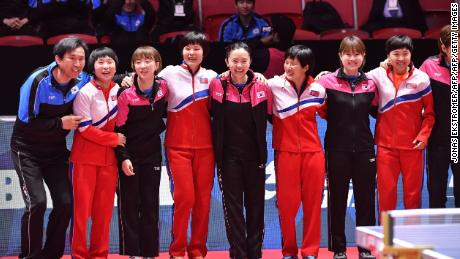 North Korea and South Korea players pose together at the Table Tennis World Championships