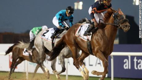Jockey Joel Rosario rides Mendelssohn (R) before winning the  Dubai Golden Shaheen horse race at the Dubai World Cup in the Meydan Racecourse on March 31, 2018 in Dubai. / AFP PHOTO / KARIM SAHIB        (Photo credit should read KARIM SAHIB/AFP/Getty Images)