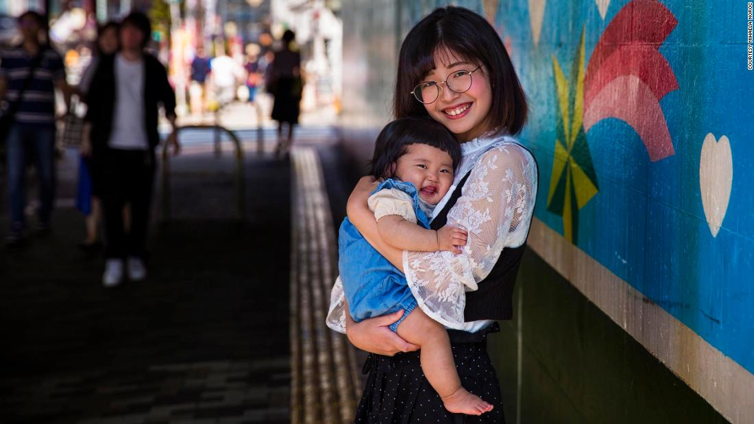 "<strong>Tokyo, Japan:</strong> This 7-month-old girl, Kanade, held by her mother, Shiori, smiled directly into her camera, thrilling Noroc only a few weeks ago during a visit to Tokyo. ""Usually, babies don't have the precision of understanding the camera,"" she said. ""There was so much joy."""