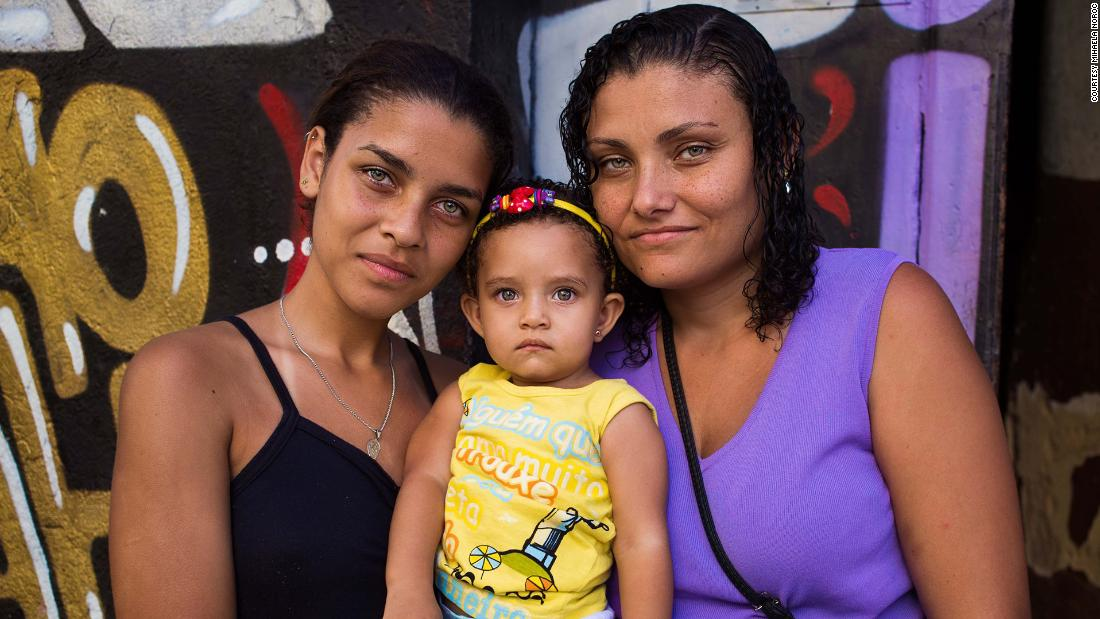 "<strong>Rio de Janeiro, Brazil:</strong> A Brazilian mother and her daughters were out in a colorful Rio neighborhood called Lapa in 2016. ""Their eyes were strikingly alike,"" said Noroc. She printed the pictures and went back to give them a set. ""They have no money, and I wanted them to have the memory."""