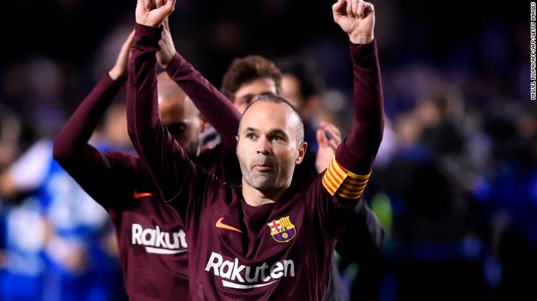 Barcelona midfielder Andres Iniesta celebrates after his team won the Spanish league against Deportivo Coruna to claim its 25th La Liga title.