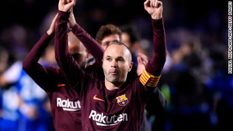 TOPSHOT - Barcelona's Spanish midfielder Andres Iniesta celebrates after his team won the Spanish league football match against Deportivo Coruna and claimed their 25th La Liga at the Riazor stadium in Coruna on April 29, 2018. (Photo by MIGUEL RIOPA / AFP)        (Photo credit should read MIGUEL RIOPA/AFP/Getty Images)