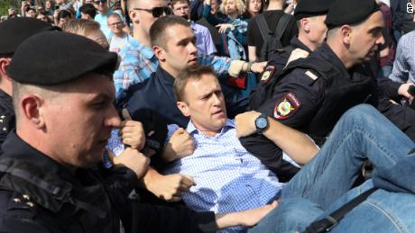 Russian police carry opposition leader Alexei Navalny, center, at an anti-Putin protest Saturday in Moscow.