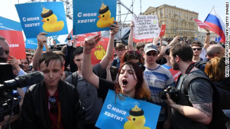 Opposition supporters hold placards and shout slogans during Saturday's anti-Putin rally in Moscow.