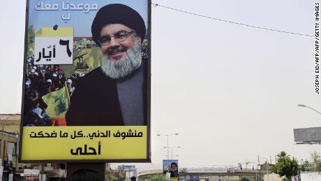 A portrait of Hezbollah leader Hassan Nasrallah is fixed on the side of a road in the mainly Shiite Muslim southern suburbs of Beirut.