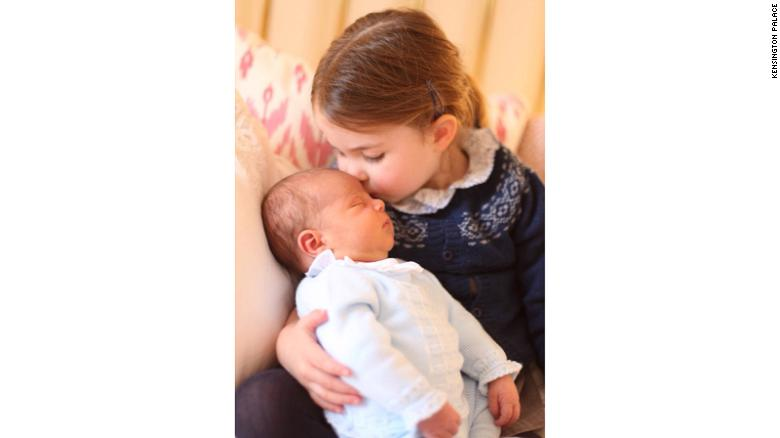 Princess Charlotte holds her new brother, Prince Louis, on May 2.