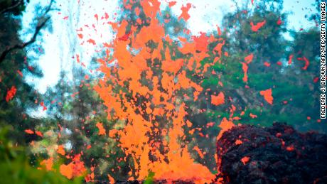 Lava escapes from a fissure in Leilani Estates May 4.