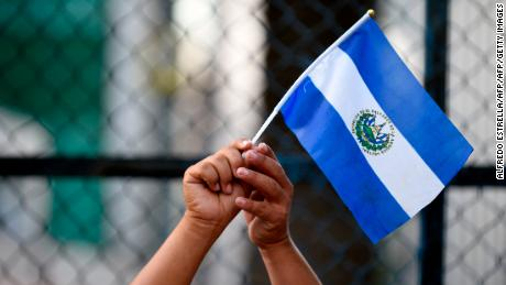 "A person taking part in the ""Migrant Viacrucis"" caravan, holds a Honduran national flag during a protest outside the US Embassy in Mexico City, on April 12, 2018.  The caravan, which prompted fury from US President Donald Trump, assembled on the border with Guatemala on March 25 but started breaking up in southern Mexico after organizers said it had abandoned its goal of reaching the US border and would end its activities with the rally in Mexico City. / AFP PHOTO / ALFREDO ESTRELLA        (Photo credit should read ALFREDO ESTRELLA/AFP/Getty Images)"