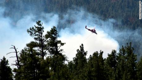 This April 30, 2018 photo provided by the U.S. Forest Service shows a helicopter fighting a wildfire in north-central Arizona.