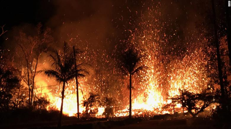 Lava fountains spray out of  a new fissure in the Leilani Estates neighborhood that erupted the evening of May 5, 2018.