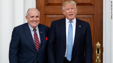 President-elect Donald Trump calls out to media as he and former New York Mayor Rudy Giuliani pose for photographs as Giuliani arrives at the Trump National Golf Club Bedminster clubhouse, Sunday, Nov. 20, 2016, in Bedminster, N.J.. (AP Photo/Carolyn Kaster)