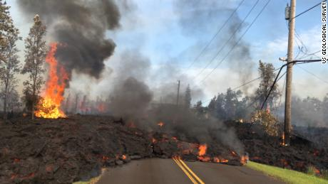 Lava slowly advances on Hookapu Street in Leilani Estates Saturday.