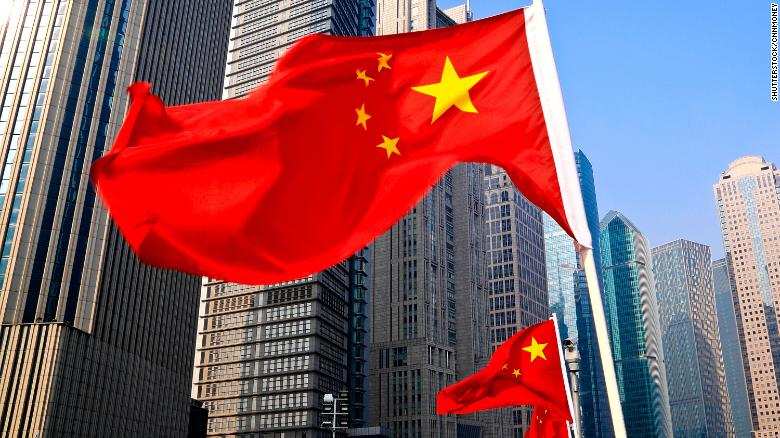 A Chinese athlete has been both praised and condemned online for a decision to drop a national flag to win a race.