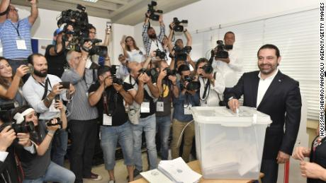 Lebanese Prime Minister Saad Hariri casts his vote at a polling station.