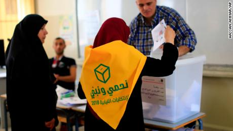 A Lebanese Hezbollah supporter casts a ballot at a polling station during the Lebanon's parliamentary elections in a southern suburb of Beirut.