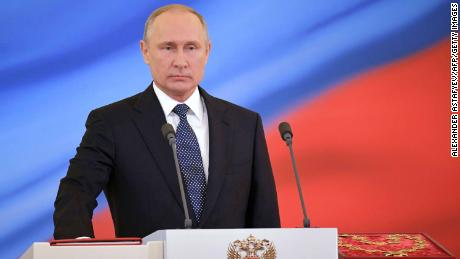 Russian president-elect Vladimir Putin takes the oath of office during a ceremony at the Kremlin in Moscow on May 7.