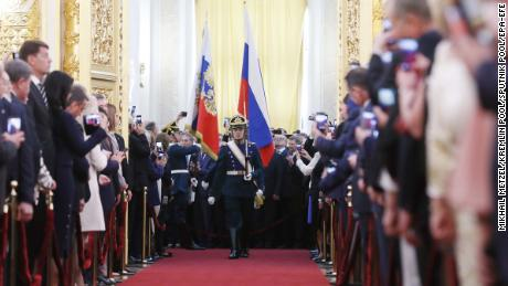 Honour Guards carry the Russian Presidential Standard and Russian National Flag during the  ceremony in the Kremlin.