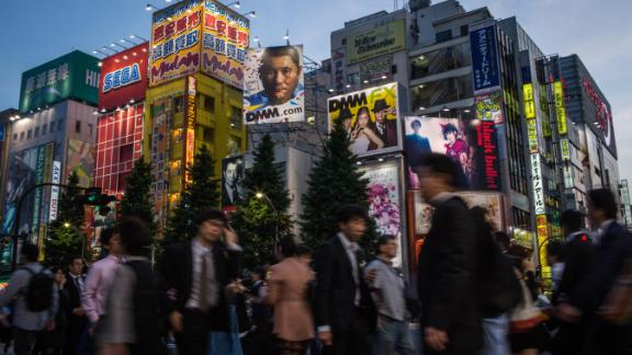 TOKYO, JAPAN - MAY 19:  People walk on the street in Akihabara, Electric Town on May 19, 2014 in Tokyo, Japan. Akihabara gained the nickname Akihabara Electric Town after World War II as it became a mecca for household electronic goods. Today Akihabara has become a major Tokyo tourist attraction and Otaku cultural center.  Otaku is a Japanese term for people with obsessive interests and is often associated with the anime and manga movements.  The district is cluttered with stores specializing in anime, video games, manga, collectibles and maid cafes.  (Photo by Chris McGrath/Getty Images)