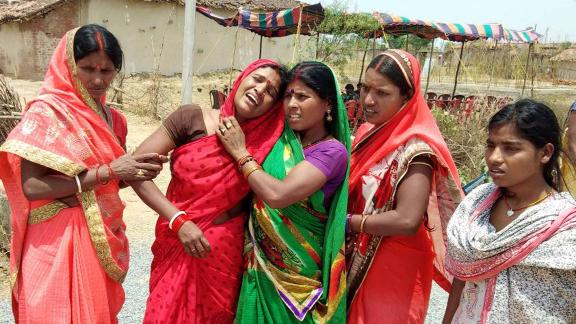 Indian relatives mourn following the rape and murder of a 16-year-old girl on May 3, at Raja Kundra Village in Chatra district of the eastern Indian state of Jharkhand.