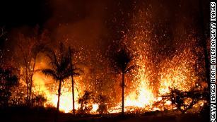 Lava spills through Hawaii neighborhood