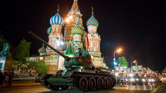 World War II era Soviet tanks T-34 makes their way through the Red Square with the St. Basil