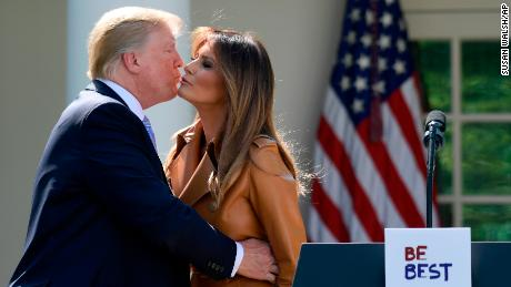 President Donald Trump kisses first lady Melania Trump following an event where Melania Trump announced her initiatives in the Rose Garden of the White House in Washington, Monday, May 7, 2018.