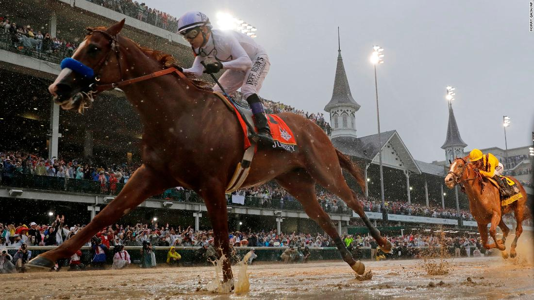 "Mike Smith rides Justify to victory during the Kentucky Derby on Saturday, May 5. Justify was a 5-2 favorite in the race, which was <a href=""https://www.cnn.com/2018/05/05/equestrian/kentucky-derby-spt/index.html"" target=""_blank"">the wettest in the history of the event.</a> More than 3 inches of rain fell at Churchill Downs."