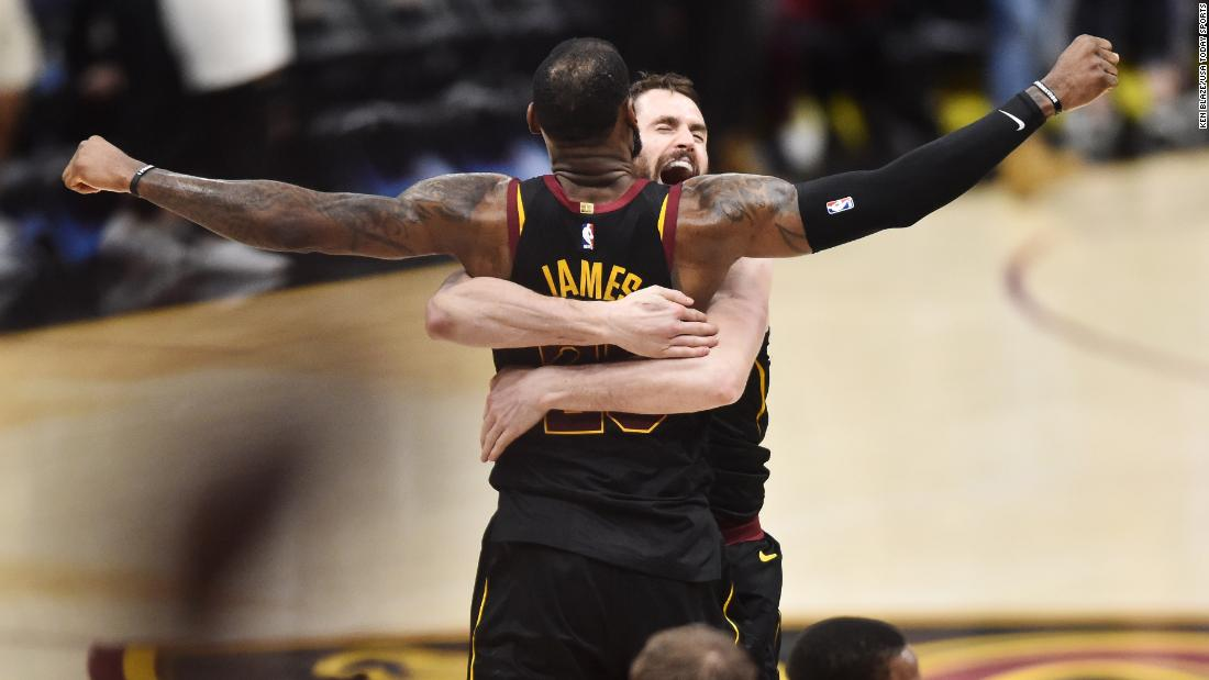 "Kevin Love hugs Cleveland teammate LeBron James after <a href=""https://bleacherreport.com/articles/2774521-lebron-james-dominates-again-as-cavaliers-win-game-3-over-raptors"" target=""_blank"">James hit the game-winning shot</a> to defeat Toronto in Game 3 of their second-round playoff series on Saturday, May 5."