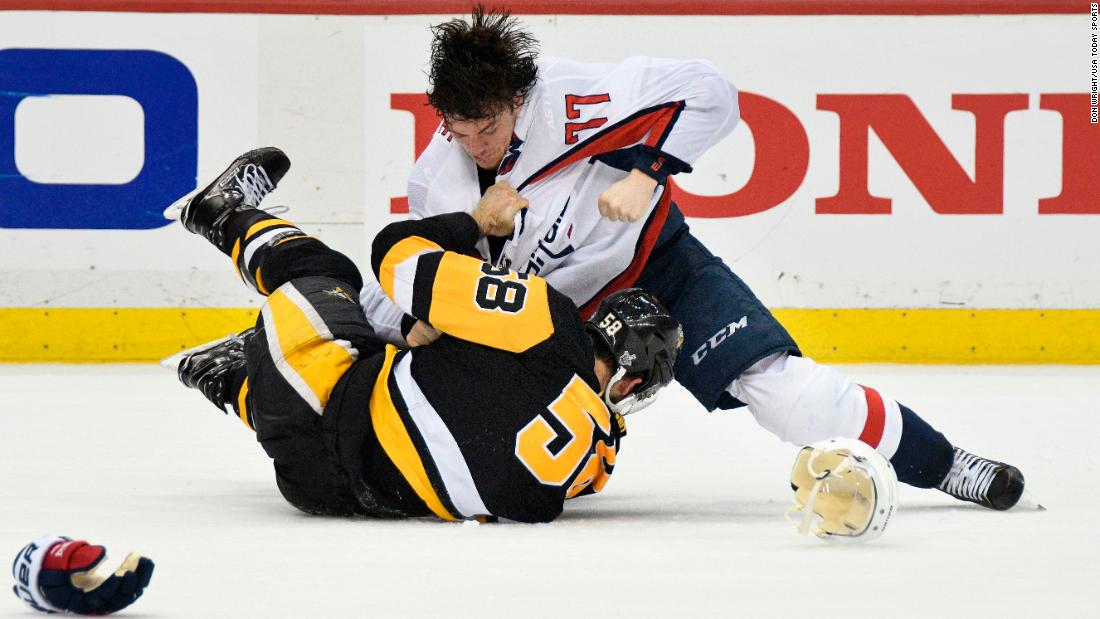 Washington forward T.J. Oshie, top, fights Pittsburgh defenseman Kris Letang during Game 4 of their second-round playoff series on Thursday, May 3.