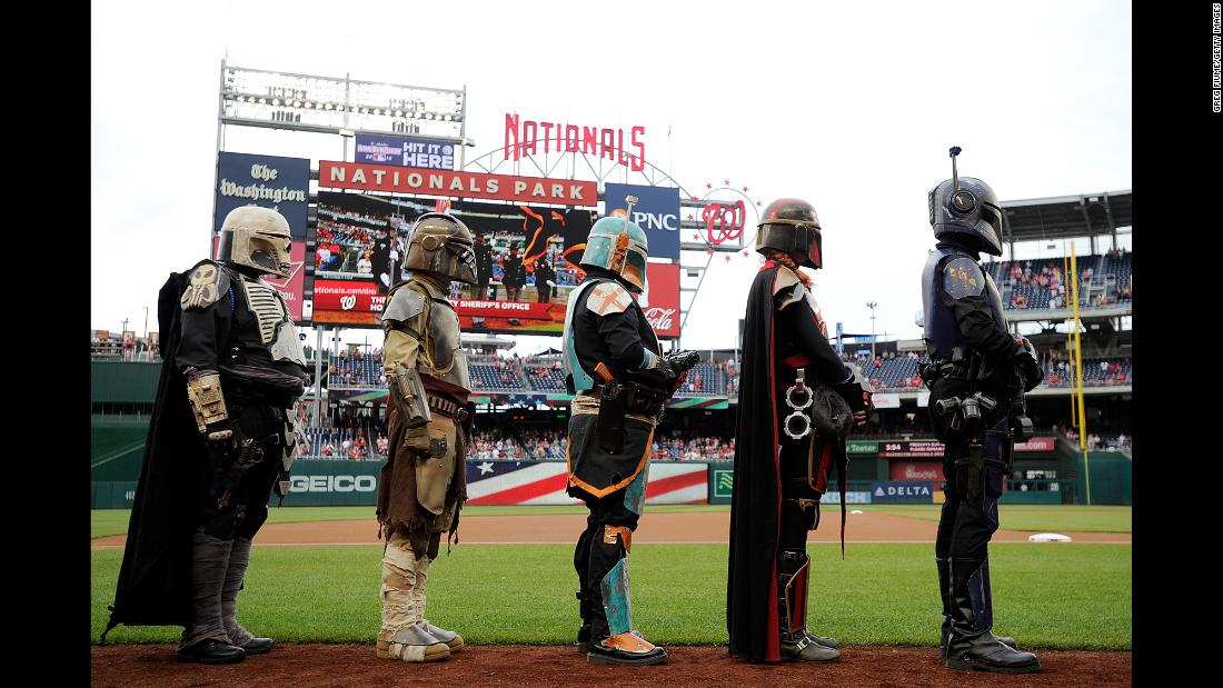 "Costumed characters line up for the National Anthem before a Major League Baseball game in Washington on Saturday, May 5. Many sports teams held ""Star Wars"" promotions this weekend. <a href=""https://www.cnn.com/2018/05/04/entertainment/what-is-star-wars-day-feat/index.html"" target=""_blank"">Related story: What is Star Wars Day?</a>"