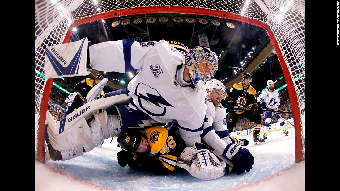 Tampa Bay goalie Andrei Vasilevskiy and forward Steven Stamkos lie on top of Boston's David Krejci during a goal-mouth scramble on Wednesday, May 2. Tampa Bay won the playoff series in five games to advance to the NHL's Eastern Conference Final.