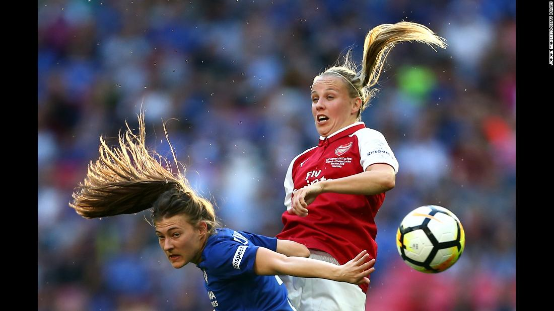 Chelsea's Hannah Blundell, left, and Arsenal's Beth Mead compete for a header during the FA Cup final in London on Saturday, May 5. Chelsea won the match 3-1.
