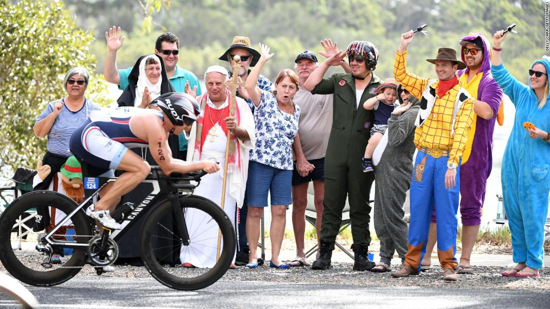 Spectators wear costumes as they cheer on Ironman competitors in Port Macquarie, Australia, on Sunday, May 6.