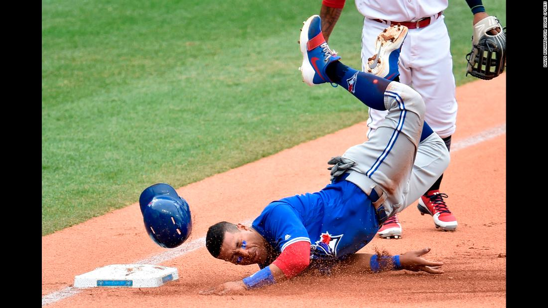 Toronto second baseman Yangervis Solarte slides into third base during a Major League Baseball game in Cleveland on Thursday, May 3.