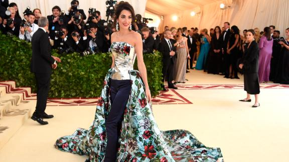 Amal Clooney wore a corset with a floral-printed train and fitted slacks, while George donned a classic tuxedo.