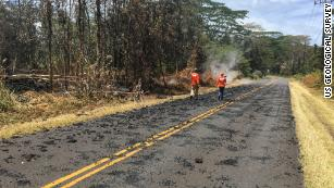USGS scientists monitor the eruption in Leilani Estates Sunday.