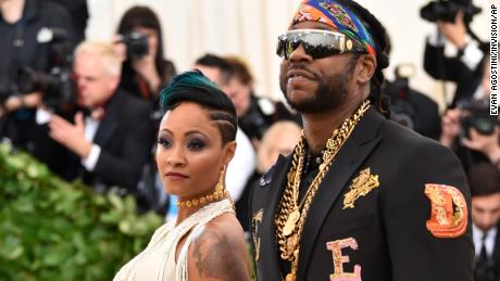2 Chainz (right) and Kesha Ward walk the red carpet at the 2018 Met Gala in New York.
