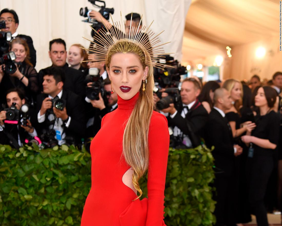 Amber Heard donned a golden halo in line with the theme. <br />