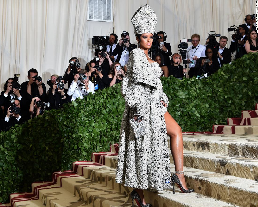 Rihanna dons a pope-inspired ensemble, including a jeweled miter. The singer co-chaired the event with Anna Wintour, Donatella Versace and Amal Clooney.<br />