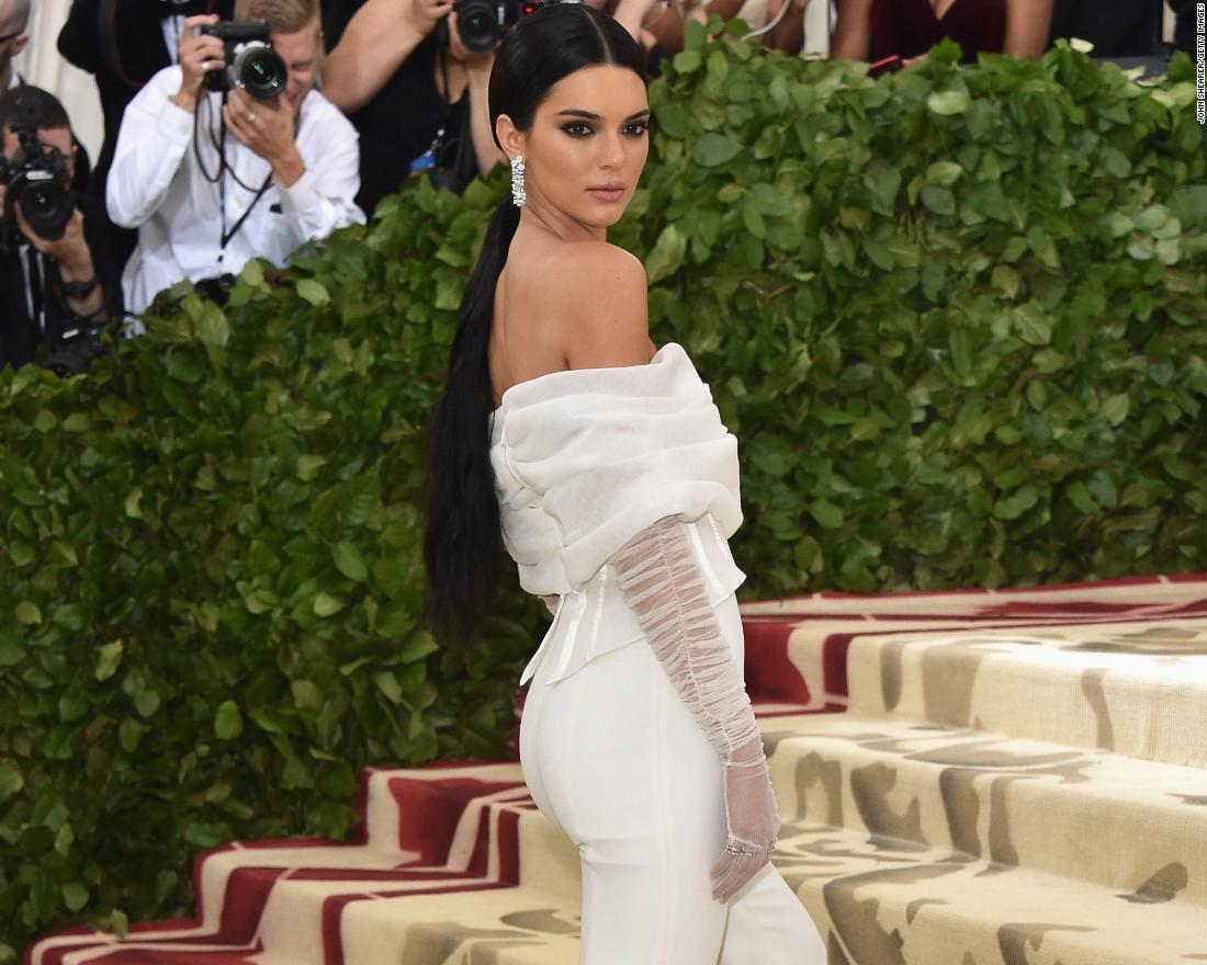 Kendall Jenner wears a white jumpsuit to the event.