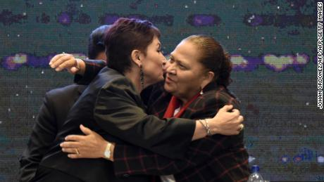 Guatemalan Attorney General Thelma Aldana (L) and newly appointed Attorney General Maria Porras, who will replace Aldana on May 17, hug each other during the ceremony in which the Public Ministry gave its annual report, in Guatemala City on May 7, 2018. - Aldana said that the joint work between the Public Prosecutor's office and a UN anti-mafia mission in Guatemala shook the power structures that perpetuated corruption in the country. (Photo by Johan ORDONEZ / AFP)        (Photo credit should read JOHAN ORDONEZ/AFP/Getty Images)