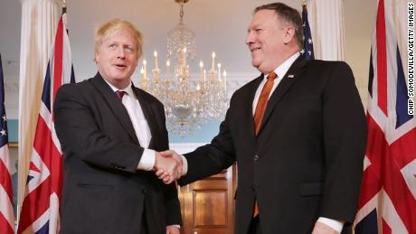"WASHINGTON, DC - MAY 07:  British Foreign Secretary Boris Johnson (L) and U.S. Secretary of State Mike Pompeo pose for photographs ahead of meetings at the U.S. State Department's Harry S. Truman headquarters building May 7, 2018 in Washington, DC. Johnson is in the United States in part to argue for the Trump Administration to continue to be a party to the 2015 Iran nuclear deal. ""The wisest course would be to improve the handcuffs rather than break them"", Johnson wrote in an editorial in the New York Times.  (Photo by Chip Somodevilla/Getty Images)"