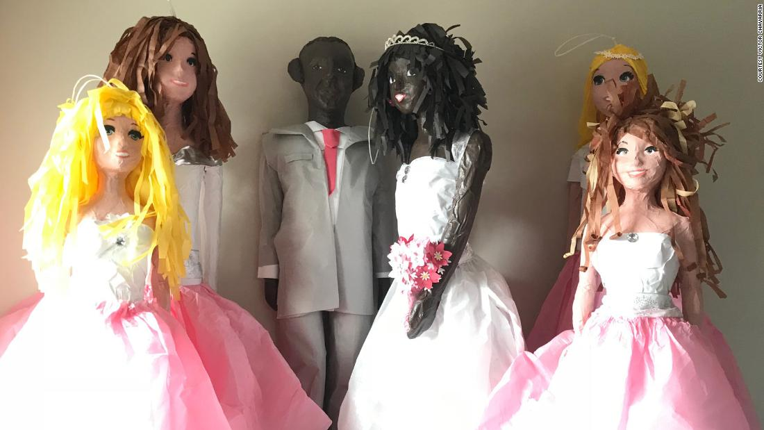 image of A Minnesota piñata maker says he is sorry for hanging black figures from his porch