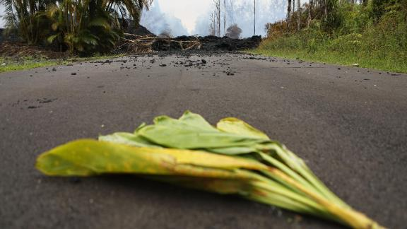 A ti leaf is left in the street near a lava flow on Monday as an offering to the Hawaiian volcano goddess Pele in the Leilani Estates neighborhood on Hawaii's Big Island
